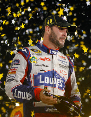 RICHMOND, VA - SEPTEMBER 10:  Jimmie Johnson, driver of the #48 Lowe's/Power of Pride Chevrolet, celebrates after clinching a spot in the 'Chase for the Sprint Cup' following the NASCAR Sprint Cup Series Wonderful Pistachios 400 at Richmond International