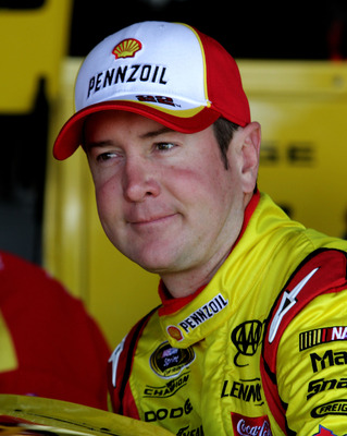 RICHMOND, VA - SEPTEMBER 09:  Kurt Busch, driver of the #22 Shell/Pennzoil Dodge, climbs in his car during practice for the Sprint Cup Series Wonderful Pistachios 400 at Richmond International Raceway on September 9, 2011 in Richmond, Virginia.  (Photo by