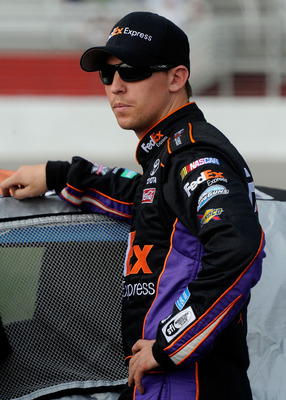 HAMPTON, GA - SEPTEMBER 03:  Denny Hamlin, driver of the #11 Charter Comm. Toyota, looks on during qualifying for the NASCAR Sprint Cup Series AdvoCare 500 at Atlanta Motor Speedway on September 3, 2011 in Hampton, Georgia.  (Photo by John Harrelson/Getty