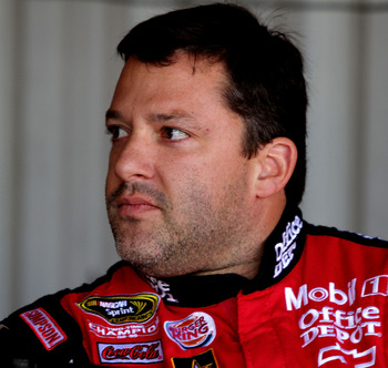 RICHMOND, VA - SEPTEMBER 09:  Tony Stewart, driver of the #14 Office Depot/Mobil 1 Chevrolet, looks on in the garage area during practice for the Sprint Cup Series Wonderful Pistachios 400 at Richmond International Raceway on September 9, 2011 in Richmond