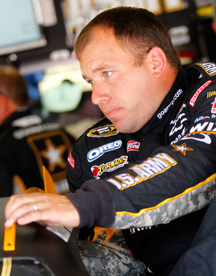 HAMPTON, GA - SEPTEMBER 03:  Ryan Newman, driver of the #39 U.S. Army Reserve Chevrolet, climbs in to his car during practice for the NASCAR Sprint Cup Series AdvoCare 500 at Atlanta Motor Speedway on September 3, 2011 in Hampton, Georgia.  (Photo by Todd