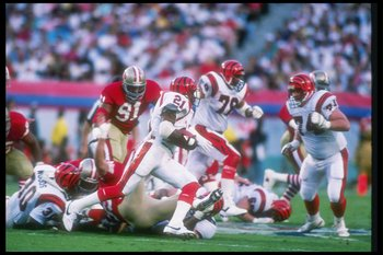 22 Jan 1989:  Running back James Brooks #21 of the Cincinnati Bengals has help moving through the San Francisco line at Super Bowl XXIII at the Joe Robbie Stadium in Miami, Florida.  The 49ers won, 20-16.  Mandatory Credit: Rick Stewart  /Allsport