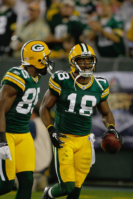 GREEN BAY, WI - SEPTEMBER 8: Randall Cobb #18 of the Green Bay Packers celebrates a touchdown with Greg Jennings #85 during the game against the New Orleans Saints at Lambeau Field on September 8, 2011 in Green Bay, Wisconsin. (Photo by Scott Boehm/Getty