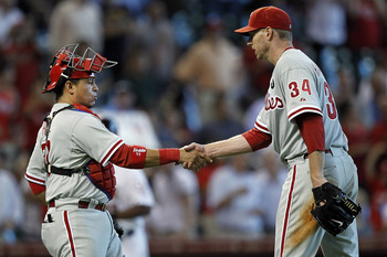 HOUSTON - SEPTEMBER 14:  Pitcher Roy Halladay #34 of the Philadelphia Phillies shakes hands with catcher Carlos Ruiz #51 after 1-0 shutout of the Houston Astros at Minute Maid Park on September 14, 2011 in Houston, Texas.  (Photo by Bob Levey/Getty Images