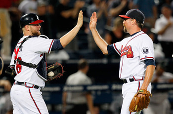 ATLANTA, GA - SEPTEMBER 13:  Scott Linebrink #19 of the Atlanta Braves celebrates with Brian McCann #16 after their 7-1 win over the Florida Marlins at Turner Field on September 13, 2011 in Atlanta, Georgia.  (Photo by Kevin C. Cox/Getty Images)