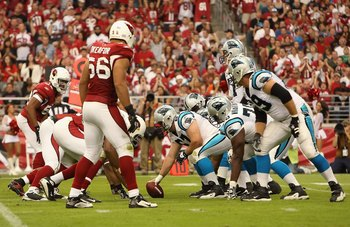 GLENDALE, AZ - NOVEMBER 01:  Center Ryan Kalil #67 of the Carolina Panthers prepares to hike the ball during the NFL game against the Arizona Cardinals at the Universtity of Phoenix Stadium on November 1, 2009 in Glendale, Arizona. The Panthers defeated t