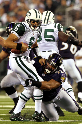 EAST RUTHERFORD, NJ - SEPTEMBER 13:  Mark Sanchez #6 of the New York Jets gets sacked by Haloti Ngata #92 of the Baltimore Ravens during their home opener at the New Meadowlands Stadium on September 13, 2010 in East Rutherford, New Jersey.  (Photo by Jim