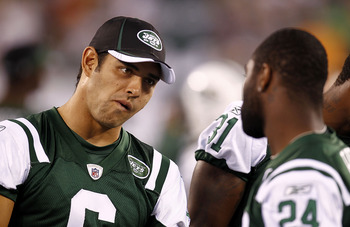 EAST RUTHERFORD, NJ - SEPTEMBER 01:  Mark Sanchez #6 talks with Darrelle Revis #24 of the New York Jets during their pre-season game at MetLife Stadium on September 1, 2011 in East Rutherford, New Jersey.  (Photo by Jeff Zelevansky/Getty Images)