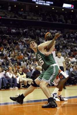 CHARLOTTE, NC - NOVEMBER 5:  Raef LaFrentz #45 of the Boston Celtics battles for position under the basket during a game against the Charlotte Bobcats on opening night at the Charlotte Coliseum on November 5, 2005 in Charlotte, North Carolina.  The Bobcat