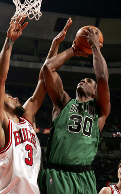 CHICAGO - DECEMBER 17:  Mark Blount #30 of the Boston Celtics is fouled while shooting the ball by Tyson Chandler #3 of the Chicago Bulls on December 17, 2005 at the United Center in Chicago, Illinois.The Bulls defeated the Celtics 118-86. NOTE TO USER: U