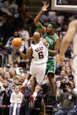 EAST RUTHERFORD, NJ - JANUARY 21:  Travis Best #6 of the New Jersey Nets jumps to the basket against Walter McCarty #0 of the Boston Celtics on January 21, 2005 at Continental Airlines Arena in East Rutherford, New Jersey. The Nets defeated the Celtics 10