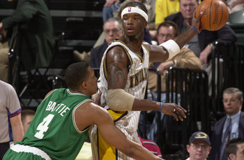 INDIANAPOLIS - APRIL 19:  Jermaine O'Neal #7 of the Indiana Pacers is defended by Tony Battie #4 of the Boston Celtics in Game one of the Eastern Conference Quarterfinals during the 2003 NBA Playoffs at Conseco Fieldhouse on April 19, 2003 in Indianapolis