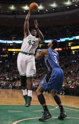 BOSTON, MA - FEBRUARY 06:  Kendrick Perkins #43 of the Boston Celtics takes a shot over Earl Clark #3 of the Orlando Magic on February 6, 2011 at the TD Garden in Boston, Massachusetts. The Celtics defeated the Magic 91-80. NOTE TO USER: User expressly ac