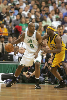 BOSTON - MAY 7:  Antoine Walker #8 of the Boston Celtics dribbles against Dale Davis #32 of the Indiana Pacers in Game seven of the Eastern Conference Quarterfinals during the 2005 NBA Playoffs at the FleetCenter on May 7, 2005 in Boston, Massachusetts.Th