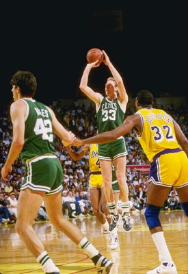 19 Feb 1988:  Guard Larry Bird of the Boston Celtics shoots the ball as Magic Johnson of the Los Angeles Lakers shoots the ball during a game at the Great Western Forum in Inglewood, California.   Mandatory Credit: Rick Stewart  /Allsport