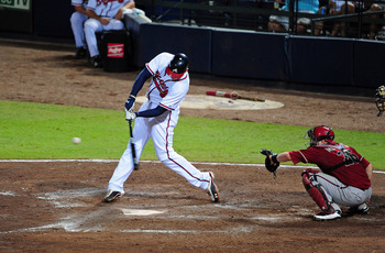 ATLANTA - AUGUST 20: Freddie Freeman #5 of the Atlanta Braves hits a 7th inning home run against the Arizona Diamondbacks at Turner Field on August 20, 2011 in Atlanta, Georgia. (Photo by Scott Cunningham/Getty Images)