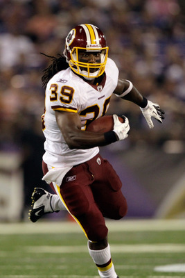 BALTIMORE, MD - AUGUST 25:  Running back Tim Hightower #39 of the Washington Redskins rushes for a touchdown against the Baltimore Ravens during a preseason game at M&T Bank Stadium on August 25, 2011 in Baltimore, Maryland.  (Photo by Rob Carr/Getty Imag