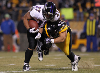 PITTSBURGH, PA - JANUARY 15:  Running back Ray Rice #27 of the Baltimore Ravens is hit by safety Troy Polamalu #43 of the Pittsburgh Steelers in the AFC Divisional Playoff Game at Heinz Field on January 15, 2011 in Pittsburgh, Pennsylvania.  (Photo by Nic