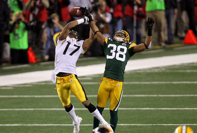 ARLINGTON, TX - FEBRUARY 06: Tramon Williams #38 of the Green Bay Packers breaks up a pass to Mike Wallace #17 of the Pittsburgh Steelers late in the fourth quarter during Super Bowl XLV at Cowboys Stadium on February 6, 2011 in Arlington, Texas.  (Photo