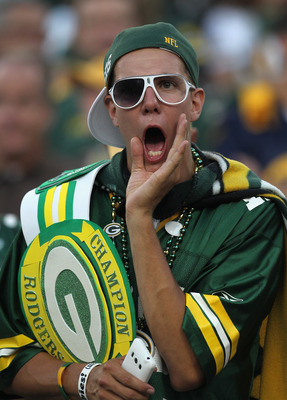 GREEN BAY, WI - SEPTEMBER 08: A fans yells during warm-ups before the Green Bay Packers take on the New Orleans Saints for the NFL opening season game at Lambeau Field on September 8, 2011 in Green Bay, Wisconsin. The Packers defeated the Saints 42-34.  (