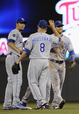 MINNEAPOLIS, MN - JULY 15: Eric Hosmer #35 (L), Mike Moustakas #8 and Alex Gordon #4 of the Kansas City Royals celebrate a win against the Minnesota Twins on July 15, 2011 at Target Field in Minneapolis, Minnesota. The Royals defeated the Twins 2-1. (Phot