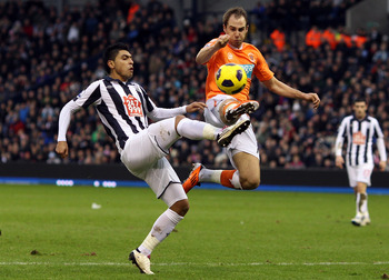 WEST BROMWICH, ENGLAND - JANUARY 15:  Luke Varney of Blackpool challenges Gonzalo Jara of West Brom during the Barclays Premier League match between West Bromwich Albion and Blackpool at The Hawthorns on January 15, 2011 in West Bromwich, England.  (Photo