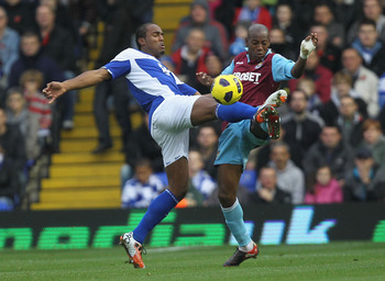 BIRMINGHAM, ENGLAND - NOVEMBER 06:  Cameron Jerome (L) of Birmingham contests with Luis Boa Morte of West Ham during the Barclays Premier League match between Birmingham City and West Ham United at St Andrews on November 6, 2010 in Birmingham, England.  (