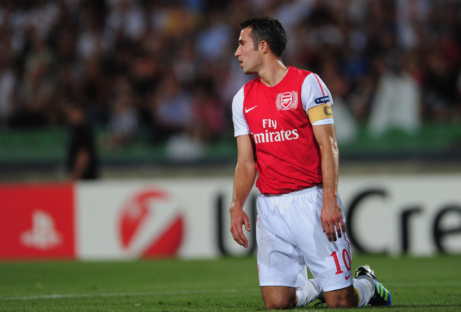 UDINE, ITALY - AUGUST 24:  Robin van Persie of Arsenal looks on during the UEFA Champions League play-off second leg match between Udinese Calcio and Arsenal FC at the Stadio Friuli on August 24, 2011 in Udine, Italy.  (Photo by Jamie McDonald/Getty Image