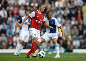 BLACKBURN, ENGLAND - AUGUST 28:  Andrey Arshavin of Arsenal competes with Michel Salgado of Blackburn Rovers during the Barclays Premier League match between Blackburn Rovers and Arsenal at Ewood Park on August 28, 2010 in Blackburn, England.  (Photo by C