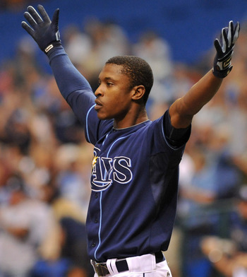 ST. PETERSBURG, FL - SEPTEMBER 07:  Outfielder B. J. Upton #2 of the Tampa Bay Rays celebrates after outfielder Desmond Jennings #8 of the Rays hits a 10th-inning, game-winning home run against the Texas Rangers September 7, 2011 at Tropicana Field in St.
