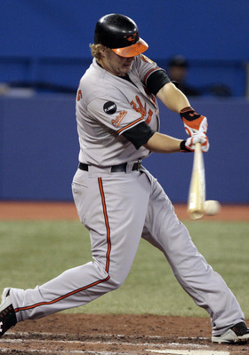 TORONTO, CANADA - SEPTEMBER 9:  Mark Reynolds #12 of the Baltimore Orioles hits against the Toronto Blue Jays during MLB action at the Rogers Centre September 9, 2011 in Toronto, Ontario, Canada. (Photo by Abelimages/Getty Images)