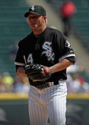 CHICAGO, IL - AUGUST 31:  Jake Peavy #44 of the Chicago White Sox reacts after giving up a home run to the Minnesota Twins at U.S. Cellular Field on August 31, 2011 in Chicago, Illinois. The Twins defeated the White Sox 7-6.  (Photo by Jonathan Daniel/Get