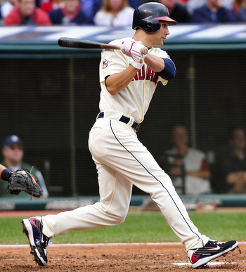 CLEVELAND, OH - SEPTEMBER 05: Grady Sizemore #24 hits a sacrifice ground ball scoring Jason Donald #16 (not shown) of the Cleveland Indians during the fifth inning against the Detroit Tigers at Progressive Field on September 5, 2011 in Cleveland, Ohio. (P