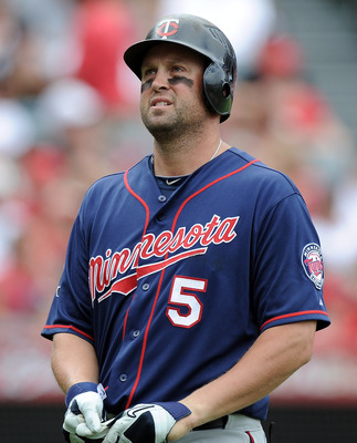 ANAHEIM, CA - SEPTEMBER 04:  Michael Cuddyer #5 of the Minnesota Twins reacts after a strikeout against the Los Angeles Angels of Anaheim at Angel Stadium of Anaheim on September 4, 2011 in Anaheim, California.  (Photo by Harry How/Getty Images)