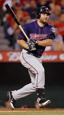 ANAHEIM, CA - SEPTEMBER 02:  Jason Kubel #16 of the Minnesota Twins hits an RBI single against the Los Angeles Angels of Anaheim in the sixth inning at Angel Stadium of Anaheim on September 2, 2011 in Anaheim, California.  (Photo by Jeff Gross/Getty Image