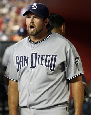 PHOENIX, AZ - SEPTEMBER 10:  Relief pitcher Heath Bell #21 of the San Diego Padres reacts in the dugout after giving up two runs in the ninth inning against the Arizona Diamondbacks during the Major League Baseball game at Chase Field on September 10, 201