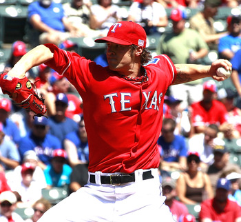 ARLINGTON, TX - SEPTEMBER 11:  C.J. Wilson #36 of the Texas Rangers delivers a pitch against the Oakland Athletics at Rangers Ballpark in Arlington on September 11, 2011 in Arlington, Texas. (Photo by Rick Yeatts/Getty Images)