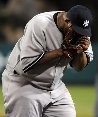 ANAHEIM, CA - SEPTEMBER 10:  C.C. Sabathia #52 of the New York Yankees reacts during the game against the Los Angeles Angels of Anaheim at Angel Stadium of Anaheim on September 10, 2011 in Anaheim, California.  (Photo by Lisa Blumenfeld/Getty Images)