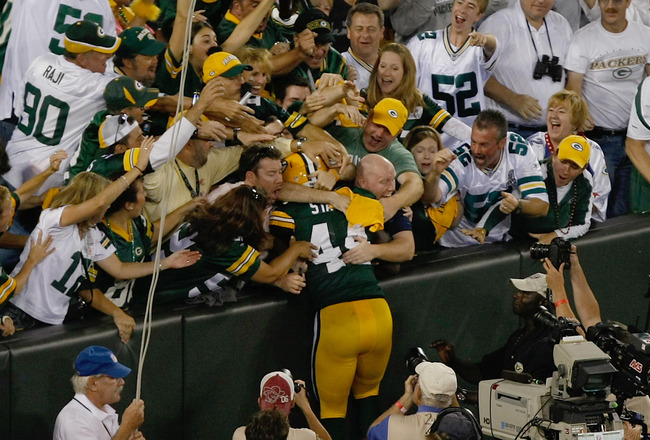 GREEN BAY, WI - SEPTEMBER 8: James Starks #44 of the Green Bay Packers jumps in the stands after scoring a touchdown during the game against the New Orleans Saints at Lambeau Field on September 8, 2011 in Green Bay, Wisconsin. (Photo by Scott Boehm/Getty
