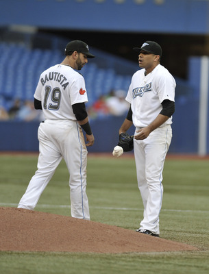 TORONTO, CANADA - JULY 27:  Jose Bautista #19 of the Toronto Blue Jays talks with teammate Ricky Romero #24 during MLB game action against the Baltimore Orioles July 27, 2011 at Rogers Centre in Toronto, Ontario, Canada. (Photo by Brad White/Getty Images)