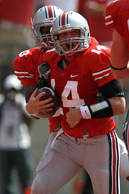 COLUMBUS, OH - SEPTEMBER 3:  Joe Bauserman #14 of the Ohio State Buckeyes celebrates after scoring during the first quarter against the Akron Zips on September 3, 2011 at Ohio Stadium in Columbus, Ohio. (Photo by Kirk Irwin/Getty Images)