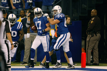 INDIANAPOLIS, IN - DECEMBER 19: Austin Collie #17 of the Indianapolis Colts scores his second touchdown of the game as he celebrates with Jacob Tamme #84 against the Jacksonville Jaguars at Lucas Oil Stadium on December 19, 2010 in Indianapolis, Indiana.