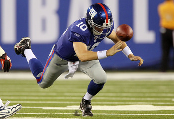 EAST RUTHERFORD, NJ - SEPTEMBER 02:  Eli Manning #10 of the New York Giants fumbles the ball in the first quarter against the New England Patriots on September 2, 2010 at the New Meadowlands Stadium in East Rutherford, New Jersey.  (Photo by Jim McIsaac/G