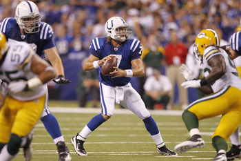 INDIANAPOLIS, IN - AUGUST 26: Curtis Painter #7 of the Indianapolis Colts looks to pass while under pressure during the first half of an NFL preseason game against the Green Bay Packers at Lucas Oil Stadium on August 26, 2011 in Indianapolis, Indiana. (Ph