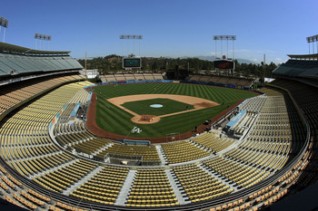 LOS ANGELES, CA - AUGUST 27:  General view of Dodger Stadium as Dodger players warm up in left field and the grounds crew prepares the infield dirt and home plate area before the game between the Colorado Rockies and the Los Angeles Dodgers at Dodger Stad