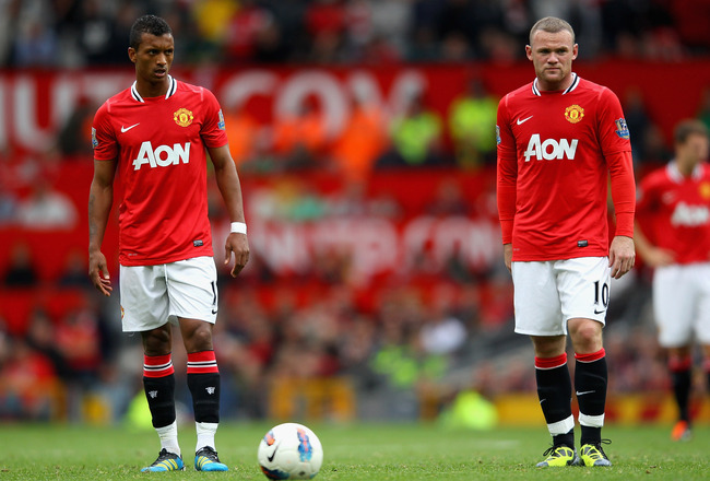 MANCHESTER, ENGLAND - AUGUST 28:  Nani and Wayne Rooney of Manchester United prepare to take a free kick during the Barclays Premier League match between Manchester United and Arsenal at Old Trafford on August 28, 2011 in Manchester, England.  (Photo by A