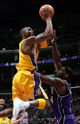 LOS ANGELES - NOVEMBER 26:  Kobe Bryant #8 of the Los Angeles Lakers goes up for a shot against Chris Webber #4 of the Sacramento Kings on November 26, 2004 at Staples Center in Los Angeles, California.  The Kings won 109-106.  NOTE TO USER: User expressl