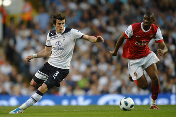 LONDON, ENGLAND - APRIL 20:  Gareth Bale of Spurs is pursued by Abou Diaby of Arsenal during the Barclays Premier League match between Tottenham Hotspur and Arsenal at White Hart Lane on April 20, 2011 in London, England.  (Photo by Laurence Griffiths/Get