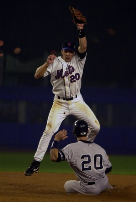 26 Oct 2000:  Jorge Posada #20 of the New York Yankees slides under the tag of Kurt Abbott of the New York Mets in the fifth inning during Game 5 of the World Series at Shea Stadium in Flushing, New York. The Yankees won the game 4-2 to clinch their third