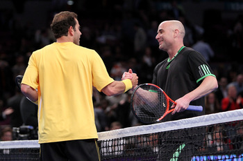 NEW YORK, NY - FEBRUARY 28:  Andre Agassi (R) congratulates Pete Sampras after Sampras won their match during the BNP Paribas Showdown at Madison Square Garden on February 28, 2011 in New York City.  (Photo by Nick Laham/Getty Images)